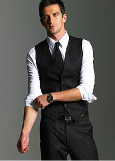 Rolled up sleeves, vest  Great idea for those outdoor weddings where they don't want to wear a coat.