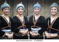 Tambunan, Sabah Malaysia. May 1, 2015 : Ladies from Dusun Tambunan ethnic wearing traditional costume poses for the camera during the Harvest Festival celeberation in Tambunan, Sabah.