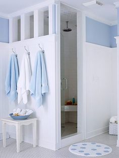 Walk-In Shower  Partial walls provide a degree of privacy in the shower and toilet area while letting light and air circulate. Tile is a water-resistant material that is a great choice in the bath. Here tile covers the entire shower interior, including the ceiling.