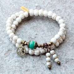 Calm, White Howlite 54 Bead Wrap Mala Bracelet with Turquoise Bead from LOVEPRAY Jewelry. Saved to Bracelets. Turquoise Jewelry, Gemstone Jewelry, Turquoise Bracelet, Beaded Jewelry, Jewelry Bracelets, Wrap Bracelets, Ganesh Pendant, African Trade Beads, Metal Beads