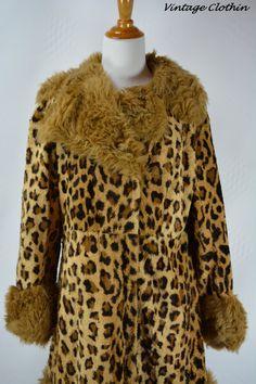 1960's Leopard Faux Fur Coat, Fur Coat, Vintage Fur Coat, Faux Fur Coat, 1960s Fur Coat, Animal Print Coat, 1960s Coat, Mod Coat, 1960s Mod Coat now available for online purchase just in time for winter  https://www.etsy.com/listing/481392924/1960s-leopard-faux-fur-coat-fur-coat?ref=shop_home_active_1 #vintage #vintageclothin #vintageshop #vintagestore #vintageseller #forsale #buyme #1960s #1960sfashion #coat #vintagecoat #animalprint #leopardprintcoat #leopard #cheetah #cheetahprint #1960s