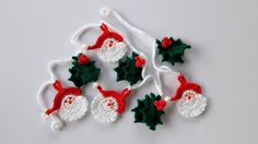 Christmas is coming!! This Santa and holly garland is the perfect addition to your Christmas decorations and will bring a smile to your face every time you see it!