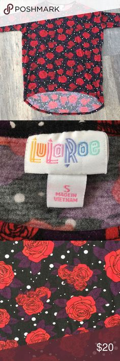 LuLaRoe Small Irma - Black Background- Red Roses Gorgeous Irma Tunic!!! Black background with white polka dots and large red roses with dark purple leaves. This has been worn and has some light wash wear, not noticeable in my opinion unless you get very close to the fabric. No stains or rips & comes from a smoke free home. LuLaRoe Tops Tunics