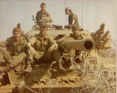 SADF veteran warriors on Olifant tank.