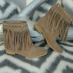HPMichael Kors Fringe Boots HONORED HOST PICK   Brand New!!  Michael Kors fringe booties. These booties feature gold stud details, fun fringe and a gold Michael Kors name plate at the back. Pair with anything!!!  Leather upper Rubber Sole  size 6 NO Box Michael Kors Shoes Ankle Boots & Booties