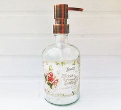 Large glass soap dispenser with slightly distressed vintage chic French rose soap label. Add a little cottage chic to your kitchen or bathroom with