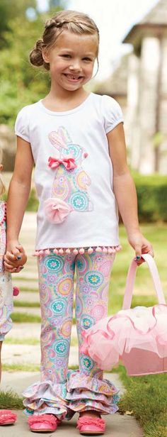 This bunny tunic and legging set will be fantastic girls Easter outfit and is sure to be big hit! A white girls Easter tunic top features a fun, colorful paisley print bunny applique and pink pom-pom trim. And paisley print pants in spring hues feature ruffled bottoms. This girls Easter pant set is available for newborn, infant, toddler and little girls.