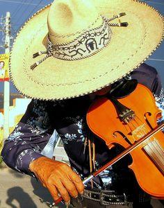 All during Fiesta... Mariachis... Viva Fiesta!