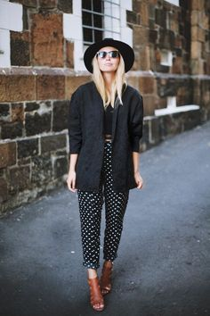 How to wear polka dots like a grown up - this high-waisted black and white polka dot pant looks great with a tailored blazer and a brimmed hat.