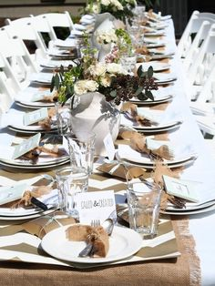 Burlap and simple white plates, clear glasses, flowers in ironstone pitchers.  So easy to personalize this setting for your wedding reception or rehearsal dinner!  Could use brown paper grocery bags for tags ... natural brown and ironstone white .. always a CLASSIC ... always CONTEMPORARY!  <3 it!
