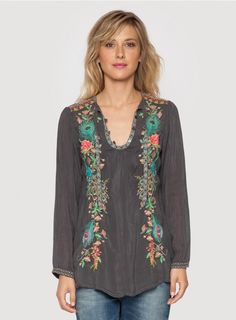 Peacock Tunic The Johnny Was PEACOCK TUNIC is the ultimate bohemian tunic top! Adorned by a stunning embroidery design that combines peacock, floral, and Art Deco-inspired motifs, this embroidered tunic top will have you turning heads! Features a keyhole neckline with three button closure and tie, and long sleeves.  - Rayon Georgette - Keyhole Tie Neckline with Three Button Closure, Long Sleeves - Signature Embroidery - Care Instructions: Machine Wash Cold, Tumble Dry Low