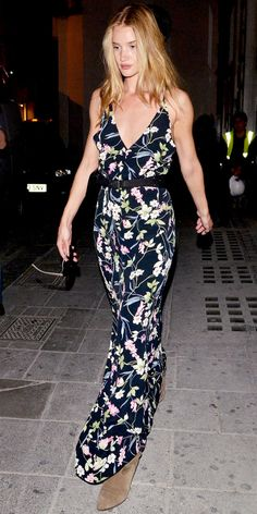 Rosie Huntington-Whiteley strolled London in a floral maxidress that she paired with suede boots.
