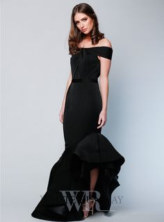 Cascade Gown. A stunning full length gown by Jadore. An off shoulder style featuring knotted detailing on the bust and slanted flared hemline.