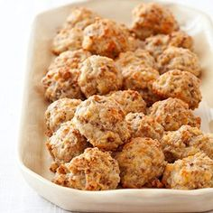 SAUSAGE BALLS:  In the South, sausage balls are a cocktail-party staple made by adding sausage and cheese to a biscuit-mix base. Most versions are addictive but greasy. For our sausage balls, basic biscuit ingredients joined sausage and sharp cheddar cheese. Buttermilk added flavor without adding fat and helped the balls hold together.