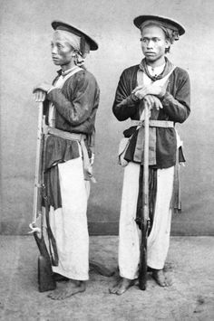 Two Chinese Army soldiers pose in Cochin, China, c. 1885.