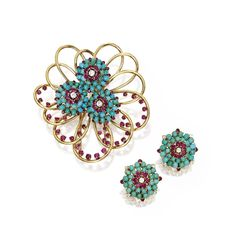 18 KARAT GOLD, DIAMOND, RUBY AND TURQUOISE BROOCH AND EARCLIPS, JOHN RUBEL The brooch of swirled floral design, set with round diamonds weighing approximately .45 carat, accented by round rubies and turquoise cabochons, the earclips of similar design, set with round diamonds weighing approximately .50 carat, accented by round rubies and turquoise cabochons, unsigned; 1940s. With box stamped W John Rubel Co.
