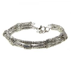 This delicate handmade bangle is made of various sizes and shape of uniquely engraved Tibetan silver beads.  It also comes with extra links at the end so it can adjust to different wrist sizes.