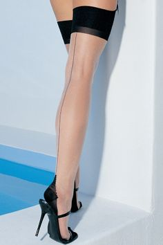 Leg Avenue Two Toned Thigh High Stockings £12.99 Sheer nude thigh highs with contrast black top, backseam and cuban heel.  www.townoftoys.co.uk