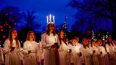 On Saint Lucia's Day, children from The Royal Danish Academy of Music sing in the Tivoli Gardens in Copenhagen