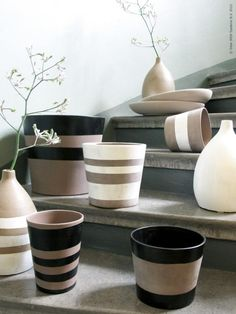 Painted pots - totally gonna do this to those cheap terra cotta colored pots. Just need painters tape!