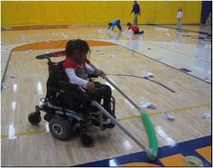 This wheelchair modification can be used to a number of activities, such as pushing a ball around in games like soccer. It allows them to build confidence and work on self esteem while being involved with the rest of the class and working on teamwork. Gross Motor Activities, Gross Motor Skills, Winter Activities, Therapy Activities, Physical Activities, Pe Equipment, Adaptive Equipment, Camping Equipment, Adapted Physical Education
