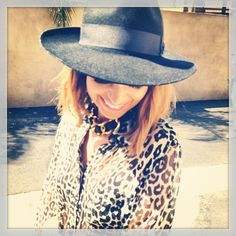 Nicole Richie: the ultimate street style maven in a classic fedora and leopard blouse