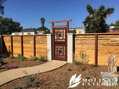 A reclaimed door was repurposed into this stunning gate entryway. Our client customized this design even further by replacing the glass door panes with copper panels. Recently completed front yard renovation. A clients awe inspiring drought tolerant design shows how water conservation principles can be applied to different styles of landscaping.