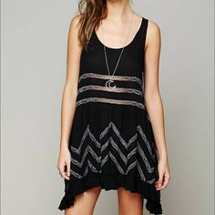 Voile and lace trapeze slip Sheer dotted slip dress with lace insert thought. Ruffles hem and sleeveless. The colors are black with grayish dots and lace the ought the entire dress. Never been worn and in perfect condition. Perfect for any season! Free People Dresses Mini
