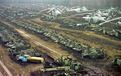 Vehicles contaminated by radioactivity lay dormant on November 10, 2000 near the Chernobyl nuclear power plant. Some 1,350 Soviet military helicopters, buses, bulldozers, tankers, transporters, fire engines and ambulances were used while fighting the nuclear accident. All were irradiated during the clean-up operation. (Efrem Lukatsky/AP) #