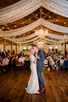 Dekoration Hochzeit – String lights and drapes make this wedding reception venue (and this bride and g… String lights and drapes make this wedding reception venue (and this bride and groom's first dance) a lot more magical. Wedding Reception Photography, Wedding Reception Venues, Wedding Reception Decorations, Wedding Ceremony, Reception Ideas, Reception Halls, Reception Party, Reception Backdrop, Tent Decorations