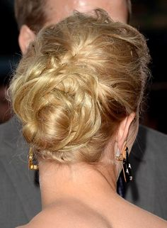 'Messy' is the next 'gorgeous' and this short updo hairstyle is a great proof of it. Twist your hair in small sections and create a casual bun with it. Keep the end of the bun free so that you can twist, fold and wrap it around itself to get a messy yet innovative look.