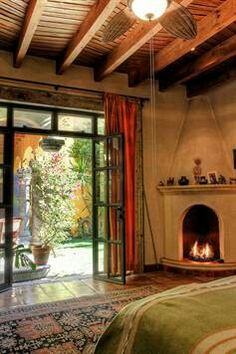 corner fireplace .  . . . I love that, with the glass doors.