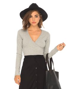 We love this bodycon wrap top! Featuring a plunge neck line and long sleeves.