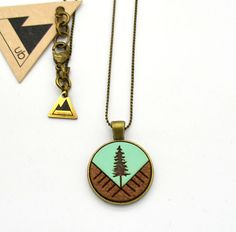 This necklace is available in both 32 and 18 lengths. Each necklace has been sealed with multiple layers of matte varnish to help protect it from the elements. Dimensions: 20 mm Materials: painted wood, wood, brass  Care instructions: Remove before swimming and bathing. Avoid contact with water. Handle with care.