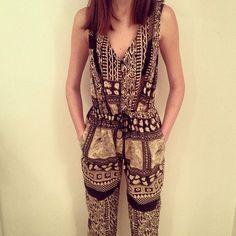 Ashleigh wears Wanderlust lattice jumpsuit