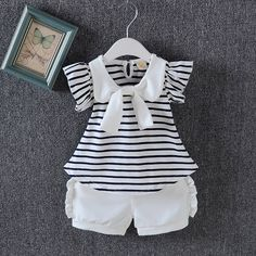 Make into pants w snaps. Baby / Toddler Striped Navy Collar Top and Ruffled Shorts Set Baby Outfits Newborn, Toddler Outfits, Kids Outfits, Cute Outfits, Girly Outfits, Trendy Outfits, Baby Girl Dress Patterns, Baby Girl Dresses, Baby Dress