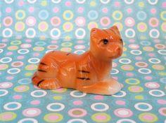 Vintage Kitsch Little Orange Kitty Cat Kitten Ceramic Figurine Japan. $5.00, via Etsy.