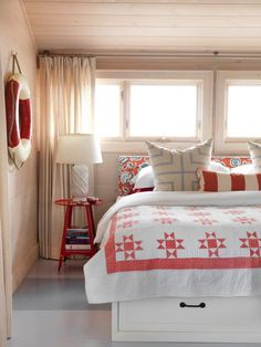 White beach house bedroom with red details