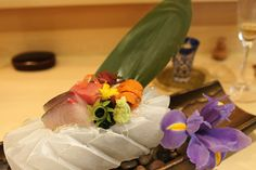 Sashimi of striped jack, toro and uni beautifully presented on a block of hand-carved ice at Urasawa, America's finest Japanese restaurant located in Beverly Hills.