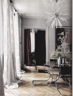 pooled drapes. amazing floors. dining room. modern chic home decor. interior decorating ideas. statement light fixture.