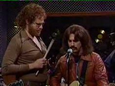 """I got a fever!  And the only prescription is MORE COWBELL!  Jim's – and mine – all time favorite SNL Skit from April 8, 2000.    Wikipedia: """"More Cowbell"""" fictionalized the recording of the song """"(Don't Fear) The Reaper"""" by Blue Öyster Cult, released July,1976. (Still love that song)  Features Christopher Walken as """"The Bruce Dickinson"""" and Will Farrell, who wrote the sketch, as fictional cowbell player Gene Frenkle. The Vimeo Link still works: https://vimeo.com/55624839"""