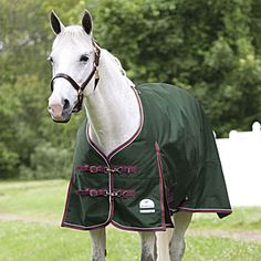 SmartPak Deluxe Turnout Blanket - Waterproof and breathable. Tough 1200 denier, grid patterned ripstop outer shell. Two stainless steel quick clip and dees front closure. Can be adjusted to gain the perfect fit.