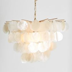 Go ultra luxe with our handcrafted Large Capiz Chandelier. With a semi-translucent design, its capiz shells naturally filtered light and add a luster that complements the Antique Gold finish of this sophisticated piece.