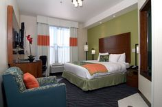 master bedroom green headboard wall, will reflect in mirror