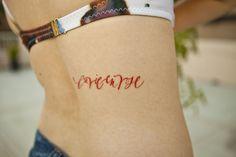 beautiful script tattoo in red