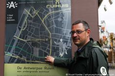 Guide Rick Philips by a map of the 'ruien' the underground canal system in Antwerp, Belgium. Photo by Stuart Forster.