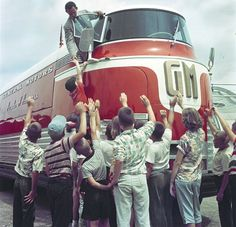 Parade of Progress - The Futurliner. This vehicle had a lighting panel that raised up 7' out of the roof and large doors that opened on one side, so people could view the display 'jet engine, that was housed inside. The jet engine didn't power the Futureliner, it was a display piece with part of the outer casing removed, so the inner workings were visible.
