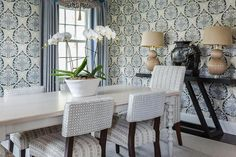 Galbraith & Paul Lotus Wallpaper decorates a dining room furnished with a gray French dining table and white turned legs. Dining Room Blue, Dining Room Walls, Dining Room Design, French Dining Tables, Woven Dining Chairs, Lotus Wallpaper, Star Wallpaper, Dining Room Wallpaper, Dining Room Inspiration