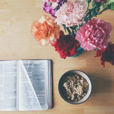 Book and flowers on We Heart It - http://weheartit.com/s/kC66frLP