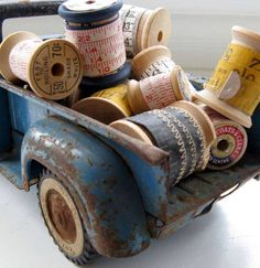 .Another fun way to use and display vintage trucks, fill the backs with spools of ribbon, key chains, show post cards, chalk, anything really that can be stacked or layered for a pretty display. Use at home to hold tv remotes, tea bags, deorative boxes of matches, small hand towels and guest soaps, fruit, or just a pretty cup with cut flowers. You get the idea :-)